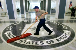 In this March 3, 2005 file photo, a workman slides a dustmop over the floor at the Central Intelligence Agency headquarters in Langley, Va. President Barack Obama has ordered intelligence officials to conduct a broad review of election-season cyberattacks, including the email hacks that rattled the presidential campaign and raised fresh concerns about Russia's meddling in U.S. elections, the White House said Friday. (AP Photo/J. Scott Applewhite)