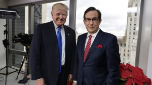 """President-elect Donald Trump poses for a photo with Chris Wallace before his interview for """"Fox News Sunday"""" at Trump Tower in New York, Saturday, Dec. 10, 2016. (AP Photo/Richard Drew)"""