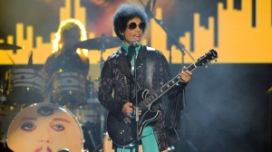 """In this May 19, 2013 file photo, Prince performs at the Billboard Music Awards at the MGM Grand Garden Arena in Las Vegas. Here's something else we lost with the death of Prince: A Netflix reality series centered on his Paisley Park home in Minnesota. A Netflix spokesperson told The Associated Press on Saturday, Dec. 10, 2016, that the online entertainment company had been in """"discussions"""" with Prince about a series, but that the project did not """"come to fruition"""" before his death in April. (Photo by Chris Pizzello/Invision/AP, File)"""