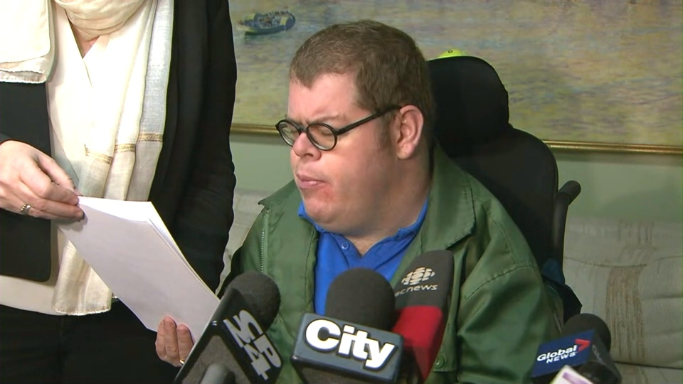 Accessibility advocate Adam Cohoon speaks at a news conference Monday December 12, 2016.