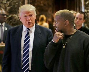 President-elect Donald Trump talks with Kanye West in the lobby of Trump Tower in New York, Tuesday, Dec. 13, 2016. (AP Photo/Seth Wenig)