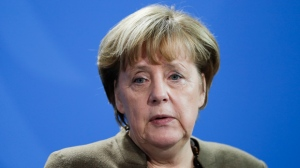 German Chancellor Angela Merkel attends a joint statement with French President Francois Hollande prior to talks at the chancellery in Berlin, Tuesday, Dec. 13, 2016. (AP Photo/Markus Schreiber