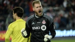 Toronto FC goalkeeper Clint Irwin (1) reacts after making a save against the Seattle Sounders during penalty kicks MLS Cup final action in Toronto on Saturday, Dec. 10, 2016. THE CANADIAN PRESS/Nathan Denette
