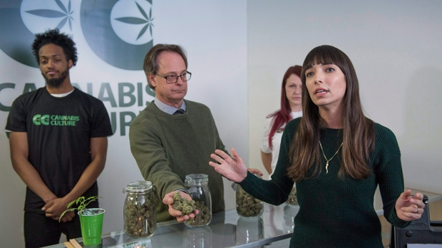 Jodie Emery, who owns the Cannabis Culture brand with her activist husband Marc Emery, left, talks to reporters at the opening of one of their stores Thursday, December 15, 2016, in Montreal. THE CANADIAN PRESS/Paul Chiasson