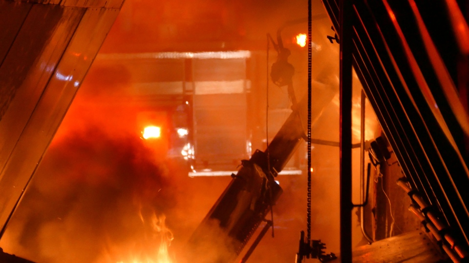 Investigators are working to determine what caused a fire that destroyed five tractor-trailers in Mississauga Saturday night. (Pascal Marchand/ CP24)