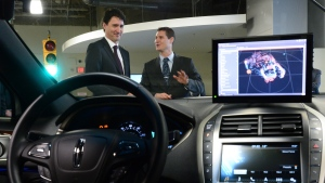 Blackberry QNX Director of Engineering Sheridan Ethier speaks to Prime Minister Justin Trudeau as he visits the Blackberry QNX facility in Ottawa on Monday, Dec 19, 2016. THE CANADIAN PRESS/Sean Kilpatrick