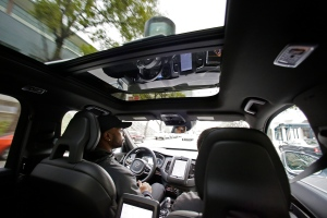 In this photo taken Tuesday, Dec. 13, 2016, Devin Greene sits in the front seat of an Uber driverless car during a test drive in San Francisco. (AP Photo/Eric Risberg)