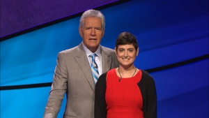 "In this Aug. 31, 2016 photo provided by Jeopardy Productions, Inc., Cindy Stowell, right, appears on the ""Jeopardy!"" set with Alex Trebek in Culver City, Calif. Stowell, who died of cancer just days before her appearance on ""Jeopardy!"" aired won six contests in a row and more than $103,000, some of which has been donated toward cancer research. Stowell's run ended when she finished second in her seventh appearance that aired on Wednesday, Dec. 21. (Courtesy of Jeopardy Productions, Inc. via AP)"
