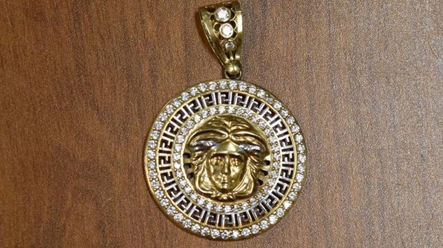 "A gold and diamond pendant recovered in ""Project Prybar"" is shown in a Toronto police handout photo."