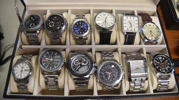 "A dozen watches recovered as part of ""Project Prybar"" are shown in a Toronto police handout photo."