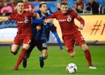 Montreal Impact midfielder Ignacio Piatti (10) is forced off the ball by Toronto FC forward Will Johnson (7) and Toronto FC forward Eriq Zavaleta (15) during first half MLS Eastern Conference playoff soccer final action in Toronto on Wednesday, November 30, 2016. THE CANADIAN PRESS/Nathan Denette
