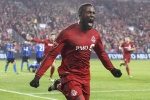 Toronto FC forward Jozy Altidore celebrates scoring his team's second goal against the Montreal Impact during first half Eastern Conference final MLS action in Toronto on Wednesday, Nov. 30, 2016. (The Canadian Press/Chris Young)