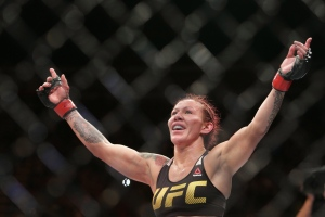 Brazil's Cristiane Justino celebrates after defeating Sweden's Lina Lansberg during a UFC Fight Night mixed martial arts bout in Brasilia, Brazil, on Sunday, Sept. 25, 2016. (AP Photo/Eraldo Peres)