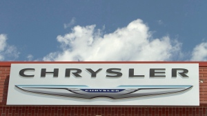 In this July 22, 2011 file photo, the Chrysler logo is displayed at a car dealership in Omaha, Neb. Fiat Chrysler is recalling nearly 89,000 cars and SUVs to fix possible fuel leaks or problems with windshield wipers, Friday, Nov. 18, 2016. The most serious recall covers nearly 35,000 Dodge Durango and Jeep Grand Cherokee SUVs worldwide from the 2016 model year. All have 3.6-liter V6 engines. A fuel tube may have been damaged in manufacturing, and that could cause a gas leak and fire. (AP Photo/Nati Harnik)