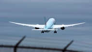 In this file photo, an Air Canada Boeing 787 Dreamliner jet departs Halifax Stanfield International Airport in Enfield, N.S. on Friday, May 23, 2014. THE CANADIAN PRESS/Andrew Vaughan