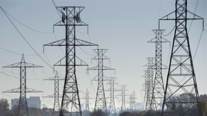 Hydro towers are seen over a golf course in Toronto on Wednesday, November 4, 2015. THE CANADIAN PRESS/Darren Calabrese