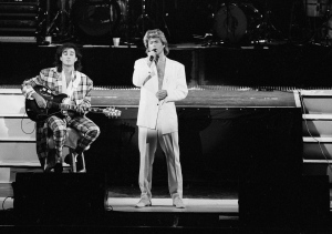 In this April 7, 1985 file photo, George Michael and Andrew Ridgeley of the British group WHAM! perform during a concert in Peking, China. (AP Photo)