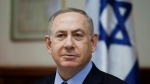 FILE -- In this Sunday, Dec. 25, 2016 file photo, Israeli Prime Minister Benjamin Netanyahu attends a weekly cabinet meeting in Jerusalem. (Dan Balilty/Pool photo via AP, File)