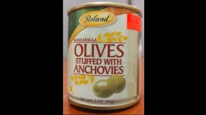 Roland brand Manzanilla Olives stuffed with anchovies are seen in this photograph provided by the Canadian Food Inspection Agency.