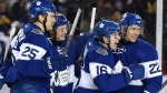 Toronto Maple Leafs centre Mitch Marner (16) celebrates his goal with teammates James van Riemsdyk (25), Tyler Bozak (42) and Nikita Zaitsev (22) during third period NHL Centennial Classic hockey action against the Detroit Red Wings, in Toronto on Sunday, Jan. 1, 2017. (The Canadian Press/Frank Gunn)