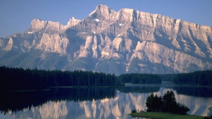 A view of Two Jack Lake in Banff National Park is shown in this undated handout photo. More Canadians are expected to leave their passports at home this summer and hit the road in Canada as the weak loonie and low gas prices prompt a deeper exploration of their own country. THE CANADIAN PRESS/HO - Travel Alberta
