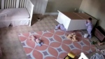 A toddler in Utah tries to lift a dresser off of his twin brother after it fell.