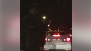 A man screams at a group of women after his vehicle stopped on Highway 427 in a video dated Jan. 4. (Facebook)