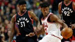 Chicago Bulls guard/forward Jimmy Butler, right, controls the ball against Toronto Raptors forward/guard Terrence Ross during the first half of an NBA basketball game Saturday, Jan. 7, 2017, in Chicago. (AP Photo/Nam Y. Huh)