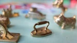 Tokens for the board game Monopoly. (MLADEN ANTONOV / AFP)