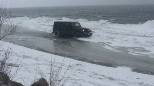 A Jeep is stuck in the ice  of Lake Ontario at Cherry Beach in Toronto Tuesday January 10, 2017. (Submitted)