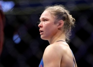 Ronda Rousey stands in the cage after Amanda Nunes forced a stoppage in the first round of their women's bantamweight championship mixed martial arts bout at UFC 207 on Friday, Dec. 30, 2016, in Las Vegas. (AP Photo/John Locher)