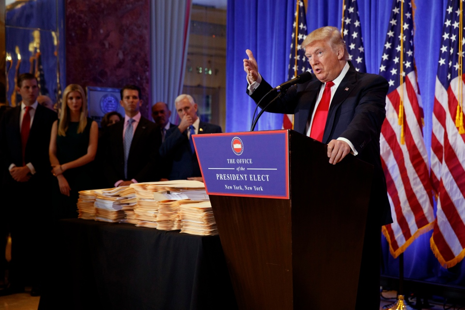 President-elect Donald Trump, accompanied by family members and Vice President-elect Mike Pence, speaks during a news conference in the lobby of Trump Tower in New York on Wednesday, Jan. 11, 2017. (AP Photo/Evan Vucci)
