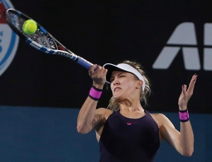 Eugenie Bouchard of Canada plays a shot to Britain's Johanna Konta during their women's semifinal singles match at the Sydney International tennis tournament in Sydney, Australia, Thursday, Jan. 12, 2017. (AP Photo/Rick Rycroft)