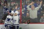 Fans react as Toronto Maple Leafs centre Nazem Kadri, left, celebrates his second goal with teammate William Nylander during third period NHL action Saturday January 14, 2017 in Ottawa. The Maple Leafs defeated the Senators 4-2. THE CANADIAN PRESS/Adrian Wyld