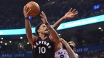 Toronto Raptors guard DeMar DeRozan (10) drives on New York Knicks center Kyle O'Quinn (9) during first half NBA basketball action in Toronto on Sunday, January 15, 2017. THE CANADIAN PRESS/Frank Gunn