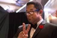 """Andre Alexis stands on stage after winning the Giller Prize for his novel """"Fifteen Dogs"""" during a gala ceremony in Toronto on Tuesday November 10, 2015.The book _ about 15 dogs gifted by gods with human traits _ was praised by jury members as an ``insightful and philosophical meditation on the nature of consciousness.'' THE CANADIAN PRESS/Chris Young"""