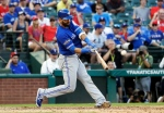 """FILE - In this Thursday, Oct. 6, 2016, file photo, Toronto Blue Jays' Jose Bautista connects for a three-run home run off Texas Rangers' Jake Diekman during the ninth inning in Game 1 of baseball's American League Division Series, in Arlington, Texas. A person with knowledge of the negotiations tells The Associated Press that outfielder Jose Bautista and the Toronto Blue Jays are """"working really hard"""" to bring him back to the club. The person spoke on condition of anonymity Monday, Jan. 16, 2017, because negotiations are ongoing. The sides are discussing one-, two- and three-year agreements. (AP Photo/David J. Phillip, File)"""