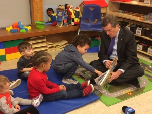 Mayor Tory is shown speaking with some children at the Dane Avenue Childcare Centre on Tuesday. The city will offer 300 additional childcare subsidies in 2017 as it works to reduce the backlog of families stuck on a waiting list for the support.