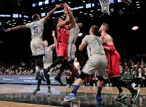 Toronto Raptors guard DeMar DeRozan (10) shoots against Brooklyn Nets guard Caris LeVert during the second quarter of an NBA basketball game on Tuesday, Jan. 17, 2017, in New York. (AP Photo/Julie Jacobson)