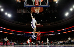 Philadelphia 76ers' Ersan Ilyasova goes up for a dunk during the first half of an NBA basketball game against the Toronto Raptors on Wednesday, Jan. 18, 2017, in Philadelphia. (AP Photo/Matt Slocum)