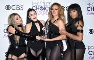Ally Brooke, from left, Lauren Jauregui, Dinah Jane, and Normani Hamilton of the musical group Fifth Harmony pose in the press room with the award for favorite group at the People's Choice Awards at the Microsoft Theater on Wednesday, Jan. 18, 2017, in Los Angeles. (Photo by Jordan Strauss/Invision/AP)