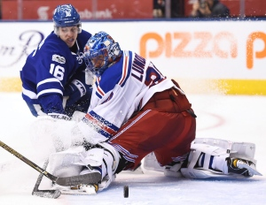 Toronto Maple Leafs centre Mitchell Marner (16) is stopped by New York Rangers goalie Henrik Lundqvist (30) during second period NHL action in Toronto on Thursday, Jan. 19, 2017. (The Canadian Press/Frank Gunn)