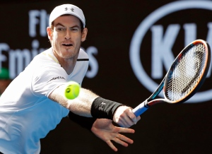 Britain's Andy Murray makes a backhand return to United States' Sam Querrey during their third round match at the Australian Open tennis championships in Melbourne, Australia, Friday, Jan. 20, 2017. (AP Photo/Kin Cheung)