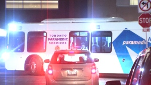 An ambulance bus transports students from a Humber College residence on Thursday night.