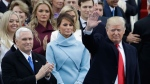 President-elect Donald Trump waves with Vice President-elect Mike Pence and his wife Melania Trump before the 58th Presidential Inauguration at the U.S. Capitol in Washington, Friday, Jan. 20, 2017. (AP Photo/Patrick Semansky)