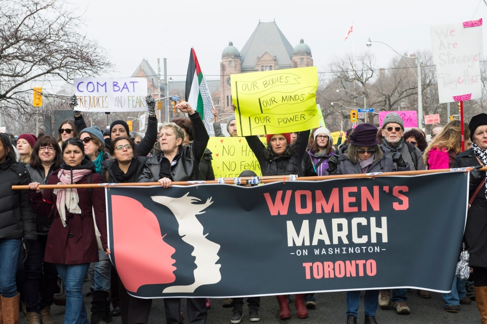 Protesters march, in support of the Women's March on Washington, in Toronto on Saturday, January 21, 2017. Protests are being held across Canada today in support of the Women's March on Washington. Organizers say 30 events in all have been organized across Canada, including Ottawa, Toronto, Montreal and Vancouver. THE CANADIAN PRESS/Frank Gunn