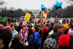 Protesters walk across Constitution Avenue near the White House for the Women's March on Washington during the first full day of Donald Trump's presidency, Saturday, Jan. 21, 2017 in Washington. (AP Photo/John Minchillo)