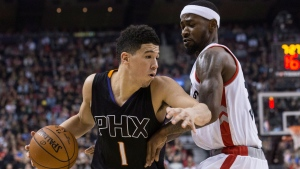 Phoenix Suns guard Devin Booker (left) drives at Toronto Raptors' Terrence Ross during first half NBA basketball action in Toronto on Sunday, January 22, 2017. THE CANADIAN PRESS/Chris Young