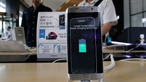In this Sept. 2, 2016 file photo, a Samsung Electronics' Galaxy Note 7 smartphone is displayed at the headquarters of South Korean mobile carrier KT in Seoul, South Korea. Samsung Electronics Co. said Monday, Jan. 23, 2017, that problems with the design and manufacturing of batteries in its Galaxy Note 7 smartphones caused them to overheat and burst into fire. (AP Photo/Ahn Young-joon, File)