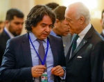 U.N. Special Envoy for Syria Staffan de Mistura, right, speaks to Mustafa Yurdakul, a member of a Turkish delegation, prior to talks on Syrian peace in Astana, Kazakhstan, Monday, Jan. 23, 2017. The talks are the latest attempt to forge a political settlement to end a war that has by most estimates killed more than 400,000 people since March 2011 and displaced more than half the country's population. (AP Photo/Sergei Grits)